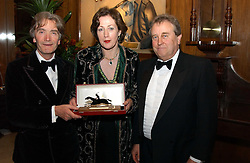 Left ot right, SIR TATTON SYKES, LADY LEGARD and ROGER SIDEBOTTOM owners of top race horse Somnus at the 2004 Cartier Racing Awards in association with the Daily Telegraph, held at the Four Seasons Hotel, London on 17th November 2004.<br />