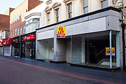 A large empty retail shop unit available to rent in Middlesborough town centre, North Yorkshire, United Kingdom. Many small businesses have been forced to close during the economic slow-down and estate agents are struggling to find new businesses to move in.
