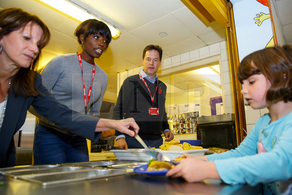 © Licensed to London News Pictures. 03/11/2014. LONDON, UK. The Deputy Prime Minister Nick Clegg, Lynne Featherstone and Lorraine Pascale serving lunch to school children at Weston Park Primary School in Crouch End, London on Monday 3 November 2014. Photo credit : Tolga Akmen/LNP