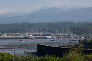 Port Penrhyn harbour view over the Menai Strait on 16th September 2020 in Bangor, Wales, United Kingdom. Port Penrhyn is a harbour located just east of Bangor in north Wales at the confluence of the River Cegin with the Menai Strait. It was formerly of great importance as the main port for the export of slate from the Penrhyn Quarry.