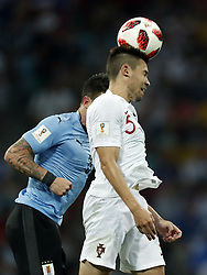 (l-r) Nahitan Nandez of Uruguay, Raphael Guerreiro of Portugal during the 2018 FIFA World Cup Russia round of 16 match between Uruguay and at the Fisht Stadium on June 30, 2018 in Sochi, Russia