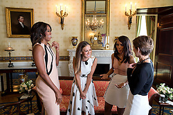 First Lady Michelle Obama, Sarah Jessica Parker and Kerry Washington participate in a conversation moderated by Cindi Leive, right, for Glamour magazine in the Blue Room of the White House, Feb. 11, 2015. (Official White House Photo by Chuck Kennedy)<br /> <br /> This official White House photograph is being made available only for publication by news organizations and/or for personal use printing by the subject(s) of the photograph. The photograph may not be manipulated in any way and may not be used in commercial or political materials, advertisements, emails, products, promotions that in any way suggests approval or endorsement of the President, the First Family, or the White House.