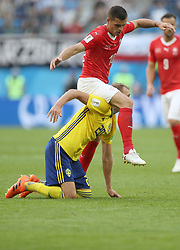 SAINT PETERSBURG, July 3, 2018  Granit Xhaka (top) of Switzerland clashes with Ola Toivonen of Sweden during the 2018 FIFA World Cup round of 16 match between Switzerland and Sweden in Saint Petersburg, Russia, July 3, 2018. Sweden won 1-0 and advanced to the quarter-final. (Credit Image: © Cao Can/Xinhua via ZUMA Wire)