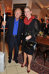 SIR TERENCE & LADY CONRAN at an exhibition at The Conran Shop entitled Red to celebrate 25 years of The Conran Shop at the Michelin Building, 81 Fulham Road, London on 19th September 2012.
