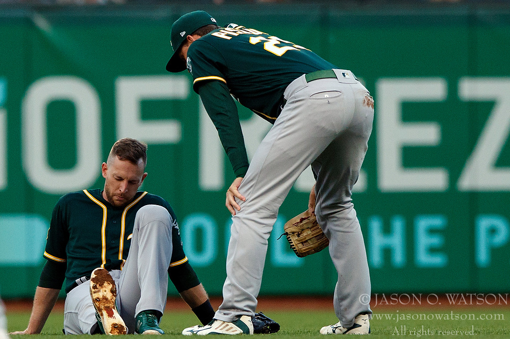 SAN FRANCISCO, CA - JULY 13: Jed Lowrie #8 of the Oakland Athletics is injured after colliding with Stephen Piscotty #25 during the third inning against the San Francisco Giants at AT&T Park on July 13, 2018 in San Francisco, California. The San Francisco Giants defeated the Oakland Athletics 7-1. (Photo by Jason O. Watson/Getty Images) *** Local Caption *** Jed Lowrie; Stephen Piscotty