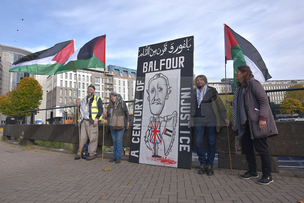 """© Licensed to London News Pictures.  01/11/2017; Bristol, UK. Bristol campaigners condemn the Balfour Declaration from 1917 on its centenary in 2007, unveiling a critical caricature depicting the then Foreign Secretary Arthur Balfour in a butchers apron weilding a knife on Palestine. The slogan, in both English and Arabic, reads 'BALFOUR - A CENTURY OF INJUSTICE.' The Balfour Declaration was a public statement issued by the British government during World War I announcing support for the establishment of a """"national home for the Jewish people"""" in Palestine, then an Ottoman region with a minority Jewish population. The declaration was step to the creation of the state of Israel. Thursday 2nd November is the centenary of the Balfour Declaration. Palestine campaigners and radical street-artists will join forces in Bristol on 02 November to exhibit the statement of street-art condemning Balfour. The caricature is three metres high and one & half metres wide. Picture credit : Simon Chapman/LNP"""