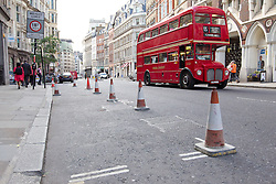 © Licensed to London News Pictures. 03/09/2013. London, UK. Parking spaces, coned off to stop use after drivers had their cars melted are seen opposite the 'Walky Talkie' building, also known as 20 Fenchurch Street, in London today (03/09/2013). The building, still under construction, has hit headlines after it was found that, due to it's curved architecture, light reflected from the building at certain times of the day was melting cars and has the ability to cook eggs. Photo credit: Matt Cetti-Roberts/LNP