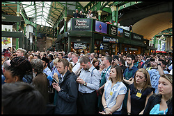 June 14, 2017 - London, United Kingdom - A moment of silence is observed as the Borough Market reopens after the London Bridge terror attack on 3 June. The market was closed after the attack on London Bridge and Borough Market that killed eight people and and injured at least 48 people. (Credit Image: © Dinendra Haria/i-Images via ZUMA Press)