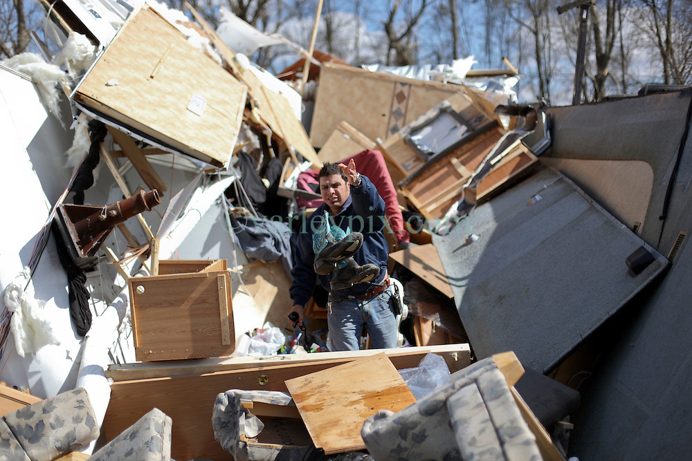 24 February 2016. Sugar Hill RV Park, Convent, Louisiana.<br /> Scenes of devastation following a deadly EF3 tornado touchdown. 2 confirmed dead. <br /> Juan Cuevas attempts to rescue all he can from his smashed trailer. Cuevas was in the trailer when the storm hit and counts himself lucky to be alive.<br /> Photo©; Charlie Varley/varleypix.com