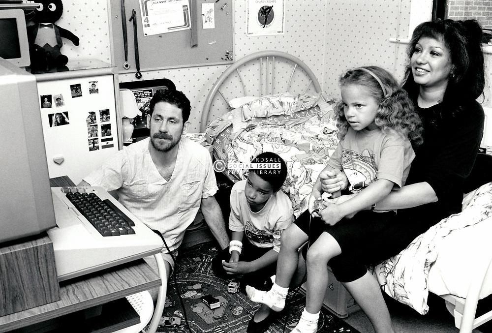 Mixed race family, Bramcote, UK 1990