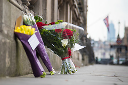 Westminster, London, March 23rd 2017. Flowers on Whitehall as investigations continue following Tuesday's terrorist attack on Westminster Bridge and in the grounds of Parliament, in which four people and their attacker were killed with over 40 injured.