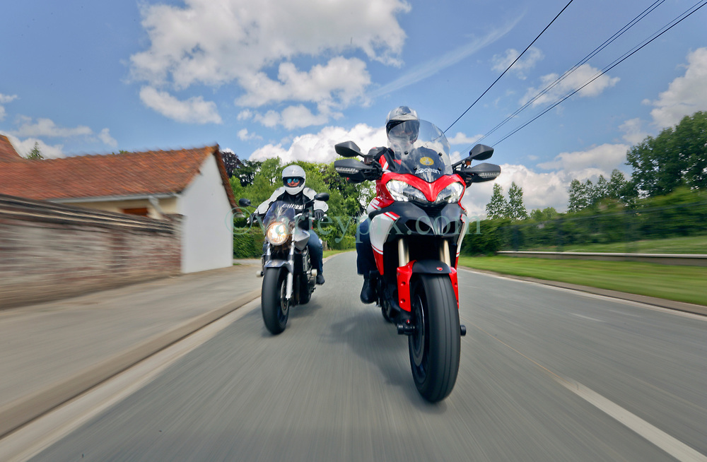14 June 2019. Pas de Calais, France.<br /> Mucking about with bikes. Great fun shooting Mark Featherstone (Silver Honda Hornet 900) and Chris Jago (Ducati Multistrade 1200) around the country lanes of Hauts de France.<br /> Photo©; Charlie Varley/varleypix.com