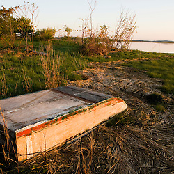 An old skiff washed up on a salt marsh at the Strawberry Hill Preserve in Ipswich, Massachusetts.  Eagle Hill River.