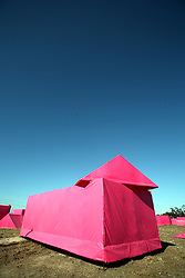 Dec 03 2007. New Orleans, Louisiana. Lower 9th Ward.<br /> Brad Pitt revisits the Lower 9th ward, devastated by Hurricane Katrina to present 'Make it Right' where architects' designs are unveiled to the public. The pink project sprung up over a couple of days, where mock housing in shocking bright pink is strewn around the still devastated Lower 9th Ward.  <br /> Photo credit; Charlie Varley.