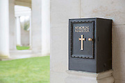 A memorial register box attached to the wall of a memorial building.  Faubourg DAmiens cemetery is the burial site of 2678 identified casualties and a memorial to thousands more from the First and Second World War.  It is looked after and managed by the Commonwealth War Graves Commission in the town of Arras, France.