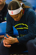 Skylar Diggins of the Dallas Wings sits on the bench against the Connecticut Sun during a WNBA preseason game in Arlington, Texas on May 8, 2016.  (Cooper Neill for The New York Times)