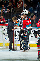 KELOWNA, CANADA - DECEMBER 2: Athletic therapist Scott Hoyer wraps a cut on the hand of Roman Basran #30 of the Kelowna Rockets during a time out against the Kootenay Ice on December 2, 2017 at Prospera Place in Kelowna, British Columbia, Canada.  (Photo by Marissa Baecker/Shoot the Breeze)  *** Local Caption ***