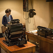 A manequin of a typist at work at the Churchill War Rooms in London. The museum, one of five branches of the Imerial War Museums, preserves the World War II underground command bunker used by British Prime Minister Winston Churchill. Its cramped quarters were constructed from a converting a storage basement in the Treasury Building in Whitehall, London. Being underground, and under an unusually sturdy building, the Cabinet War Rooms were afforded some protection from the bombs falling above during the Blitz.