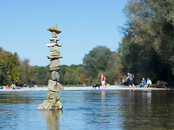 Stack of rocks balancing in Isar river, Bavaria, Germany