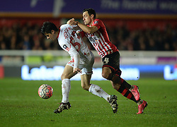 Joao Teixeira of Liverpool battles for the ball with Alex Nicholls of Exeter City - Mandatory byline: Alex James/JMP - 08/01/2016 - FOOTBALL - St James Park - Exeter, England - Exeter City v Liverpool - FA Cup Third Round