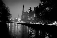 1/3: Catholics in torchlight parade in front of the church in Lourdes at Easter / The catholic pilgrimage of Lourdes, France