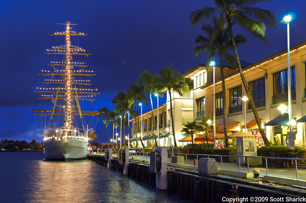 A tall ship docked at the Aloha Tower in Honolulu, Hawaii.