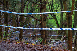 © Licensed to London News Pictures. 12/12/2019. Gerrards Cross, UK. Police tape marks an outer cordon at the site of a search operation as the Metropolitan Police Service confirm they are searching woodland in Beaconsfield, Buckinghamshire in connection with the disappearance and murder of Mohammed 'Shah' Subhani. Police have been in the area conducting operations on Hedgerley Lane since Thursday 5th December 2019 and are combing wooded area with specialist officers, assisted by specialist search dogs. Photo credit: Peter Manning/LNP