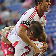 Tim Cahill, (top), New York Red Bulls, celebrates a goal by Dax McCarty, (hidden) along with team mate Jonny Steele during the New York Red Bulls V New England Revolution, Major League Soccer regular season match at Red Bull Arena, Harrison, New Jersey. USA. 20th April 2013. Photo Tim Clayton