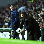 Blackburn Rovers' Graeme Souness hands back the ball watched by Manchester United's Alex Ferguson.