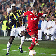Fenerbahce's Moussa Sow (L) and Benfica's Maxi Pereira (R) during their UEFA Europa League Semi Final first match Fenerbahce between Benfica at Sukru Saracaoglu stadium in Istanbul Turkey on Thursday 25 April 2013. Photo by Aykut AKICI/TURKPIX
