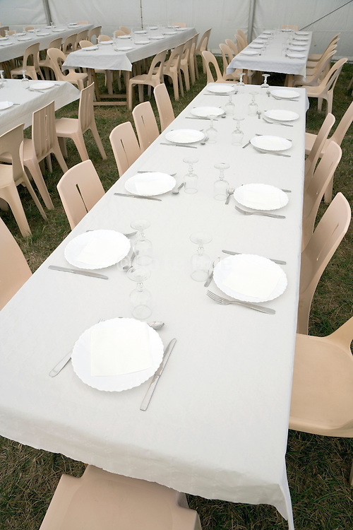 rows of chairs and tables at a big outdoor party