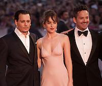 Actor Johnny Depp, actress Dakota Johnson, director Scott Cooper at the gala screening for the film Black Mass at the 72nd Venice Film Festival, Friday September 4th 2015, Venice Lido, Italy.