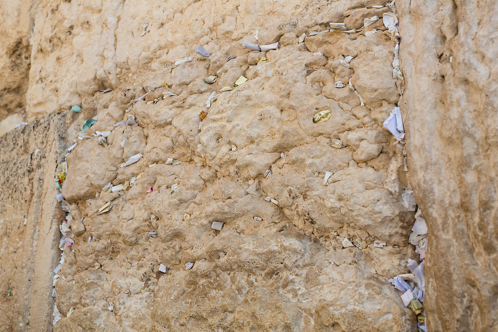 Notes containing prayers and messages which were left by visitors in the cracks between the stones of the Western Wall are seen at Judaism's holiest prayer site, in the Old City of Jerusalem, Israel, on September 17, 2017. The clean-up which takes place ahead of the upcoming Jewish New Year Holiday, clears the wall's crevices and frees up space for more notes that people of all faiths slip between its stones, believing that requests deposited at the site are more likely to be heard by God.