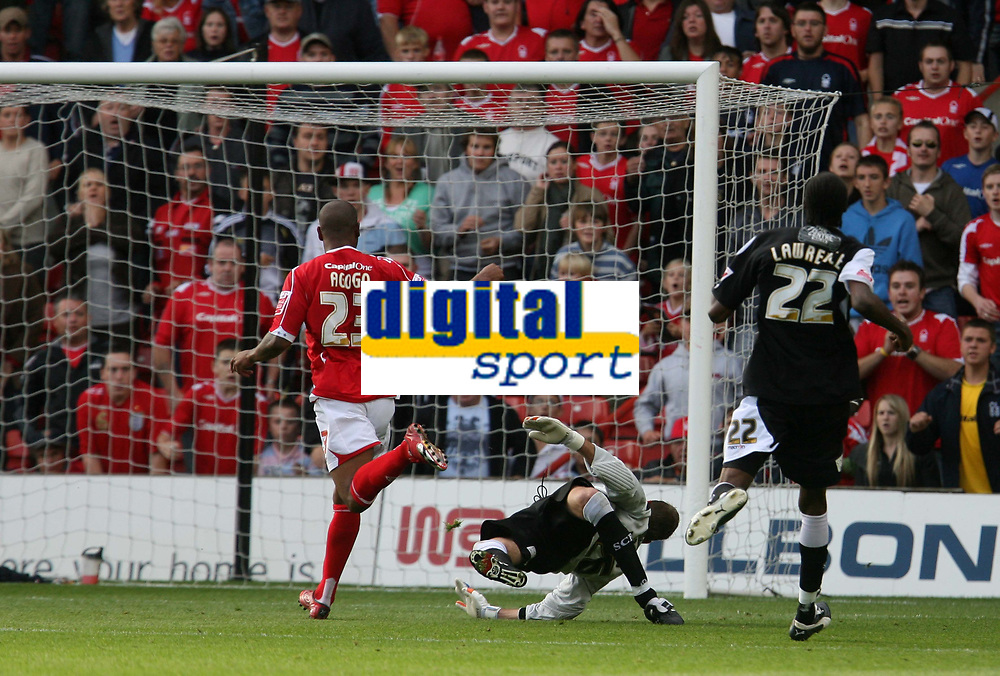 Photo: Pete Lorence.<br />Nottingham Forest v Swansea City. Coca Cola League 1. 30/09/2006.<br />Junior Agogo sends the ball past a helpless Andrew Oakes to score Nottingham's 3rd goal.