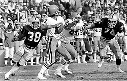 Oakland Raiders Rufus Best and Dave Pear rush Cleveland Browns QB Brian Sipe. (1979 photo/Ron Riesterer)