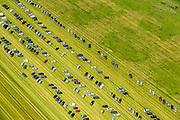 Nederland, Limburg, Gemeente Sittard-Geleen, 26-06-2014; parkeerterrein in de weilanden voor het Oud-Limburgs Schuttersfeest in Papenhoven-Grevenbicht.<br /> Improvised parking lot for festival.<br /> luchtfoto (toeslag op standaard tarieven);<br /> aerial photo (additional fee required);<br /> copyright foto/photo Siebe Swart.