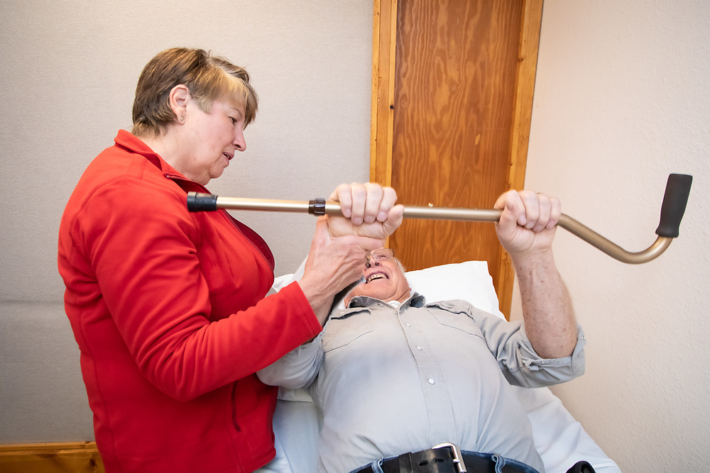 Physical Therapist Kay Schafer helps Art Nordyke master exercises as he recovers from shoulder surgery.
