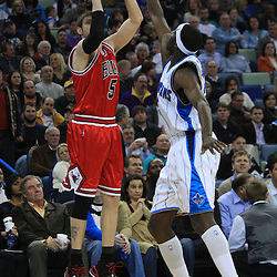 04 February 2009:  Chicago Bulls forward Andres Nocioni (5) shoots over New Orleans Hornets forward Julian Wright (32) during a 93-107 loss by the New Orleans Hornets to the Chicago Bulls at the New Orleans Arena in New Orleans, LA.