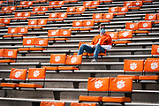 Clemson fan Alex Meister sits in the stands, reorganized for social distancing, before a nonconference game between Clemson University and The Citadel at Memorial Stadium in Clemson, South Carolina on Saturday, September 19, 2020.