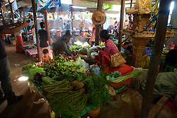 Selling Vegetables At Market