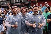 Scotland football supporters gather in the rain near London's Leicester Square before tonight's match between England and Scotland at Wembley, during the European Championships (postponed for a year because of the Covid pandemic), on 18th June 2021, in London, England. The two nations have traditionally been fierce sporting rivals and this is the first time that Scotland has qualified for the 'Euros' for 23 years.