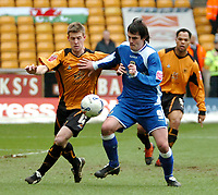Photo: Ed Godden.<br />Wolverhampton Wanderers v Cardiff City. Coca Cola Championship. 11/03/2006. <br />Maurice Ross (L) takes on Cardiff's Steven Thompson.