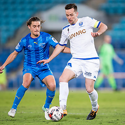 BRISBANE, AUSTRALIA - SEPTEMBER 20: Matthew Foschini of South Melbourne controls the ball under pressure from Tom Miller of Gold Coast City during the Westfield FFA Cup Quarter Final match between Gold Coast City and South Melbourne on September 20, 2017 in Brisbane, Australia. (Photo by Gold Coast City FC / Patrick Kearney)