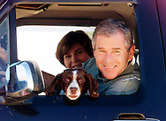 Texas Governor and Republican presidential candidate George W. Bush and his wife Laura smile at a visitor while enjoying a ride in their pickup truck with dog Spot, on their rural Crawford, Texas ranch September 16, 2000. The late afternoon rides are one of their daily rituals while relaxing on the ranch.   REUTERS/Rick Wilking