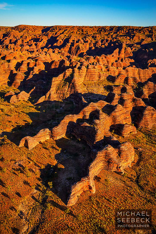 An aerial photograph of the intricate sandstone beehive formations of Purnululu, taken in the early morning.<br /> <br /> Limited Edition Print