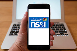 Using iPhone smartphone to display logo of NS&I  , National Savings and Investments .