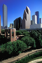 Daytime view of the Houston, Texas skyline with the Wortham Center Waterfall in the foreground.