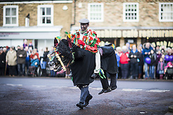 January 14, 2017 - Whittlesey, Cambridgshire, UK - Whittlesey UK. Picture shows a member of the Rutland Morris dancers at the 38th Whittlesey Straw Bear Festival this weekend. In times past when starvation bit deep the ploughmen of the area where drawn to towns like Whittlesey, They knocked on doors begging for food & disguised their shame by blackening their faces with soot. In Whittlesey it was the custom on the Tuesday following Plough Monday to dress one of the confraternity of the plough in straw and call him a Straw Bear. The bear was then taken around town to entertain the folk who on the previous day had subscribed to the rustics, a spread of beer, tobacco & beef. The bear was made to dance in front of houses & gifts of money, beer & food was expected. (Credit Image: © Andrew Mccaren/London News Pictures via ZUMA Wire)