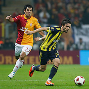 Galatasaray's Juan Emmanuel CULIO (L) and Fenerbahce's Gokhan GONUL (R) during their Turkish superleague soccer derby match Galatasaray between Fenerbahce at the Turk Telekom Arena in Istanbul Turkey on Friday, 18 March 2011. Photo by TURKPIX