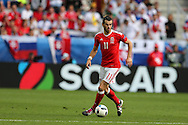 Gareth Bale of Wales in action.  Euro 2016, Wales v Slovakia at Matmut Atlantique , Nouveau Stade de Bordeaux  in Bordeaux, France on Saturday 11th June 2016, pic by  Andrew Orchard, Andrew Orchard sports photography.